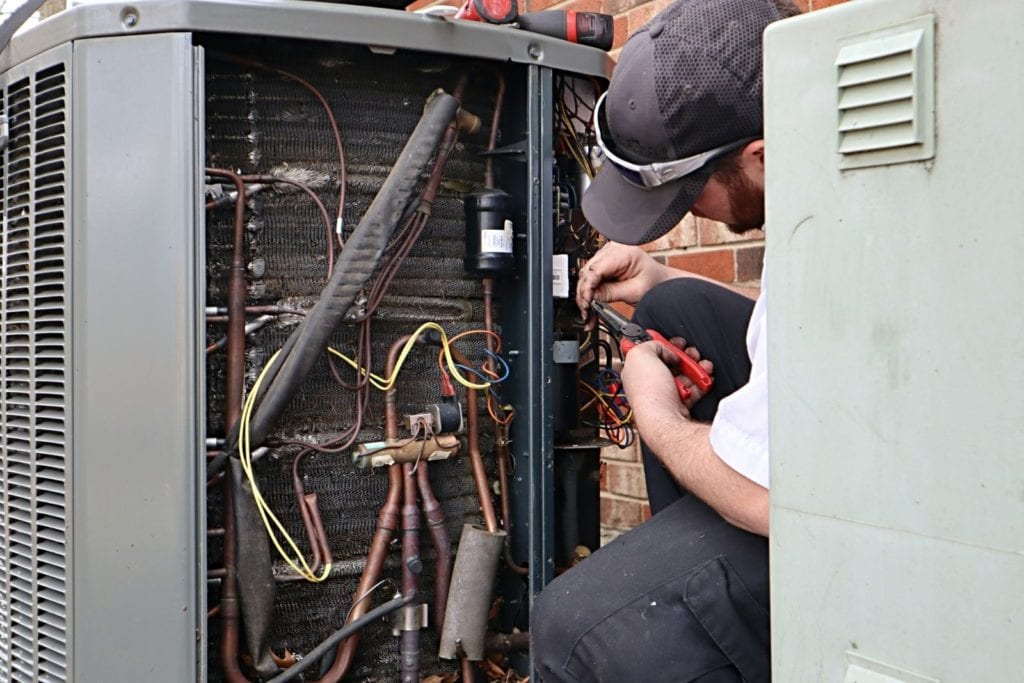 service-repair-being-done-on-a-heat-pump-hvac-system